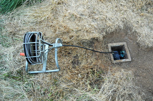 drain cleaning snake snaking a septic tank in muldrow, ok